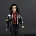 Michael Jackson doll car club badges close up