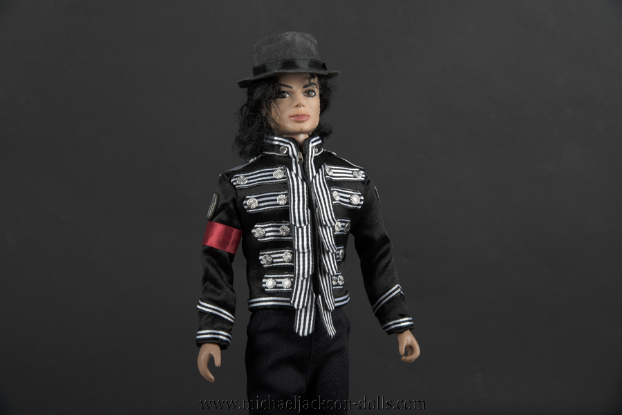 Michael Jackson doll jacket with striped bands close up
