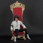 Michael Jackson doll on red chair